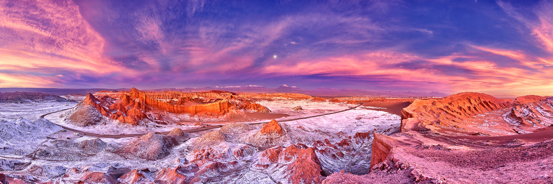 A full moon rising through a vibrant twilight, Atacama Desert, Chile.