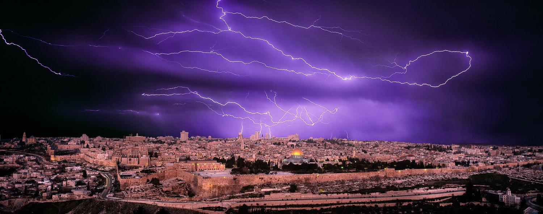Lighnting flashes over the Holy City of Jerusalem, Israel.