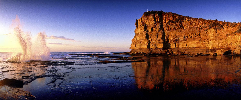 Calm seas and a golden sunrise at Terrigal, NSW, Australia.
