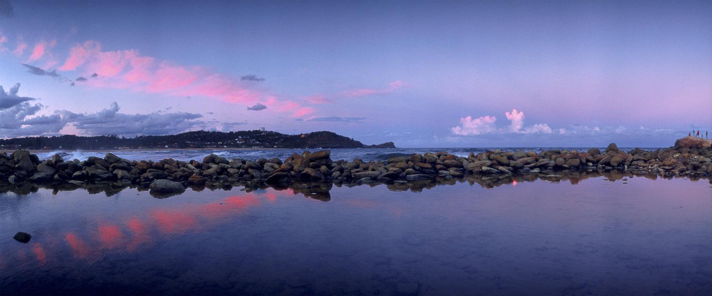 Glowing purple twilight over Avoca Beach pool, Central Coast, NSW, Australia.