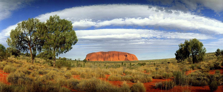 Clouds forming a halo over Uluru, NT, Australia.