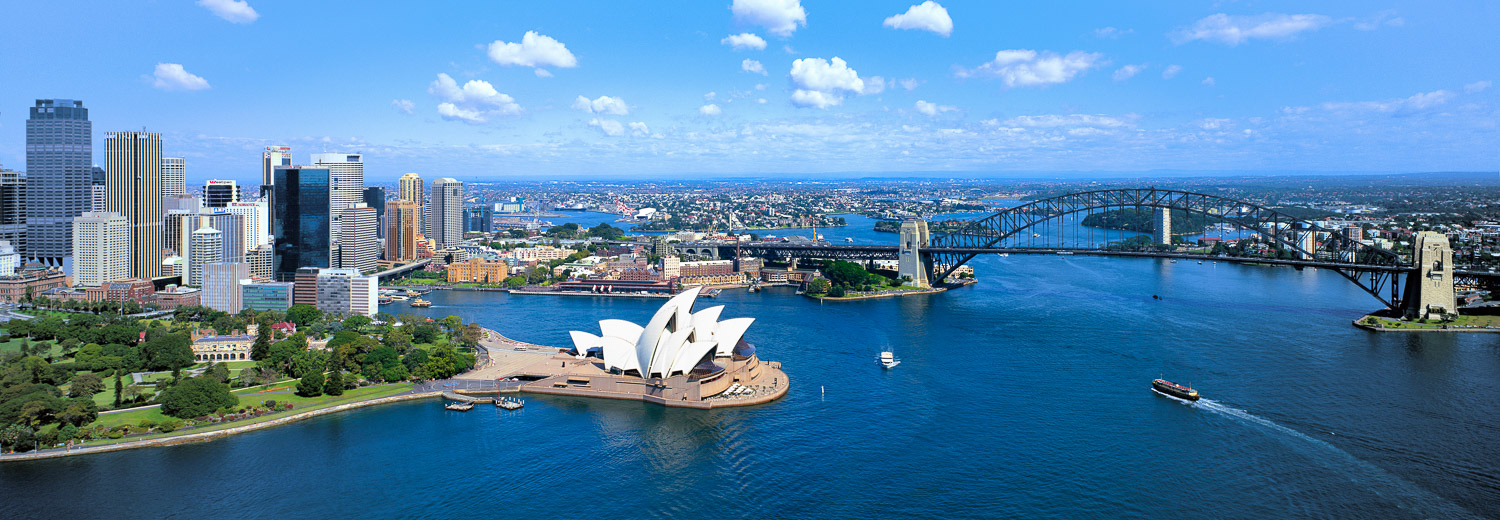 An aerial view of Sydney Harbour, showing the Bridge and Opera House, NSW, Australia.
