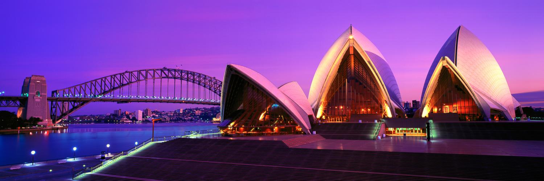 Lights on Sydney Opera House just before dawn, Sydney, NSW, Australia.