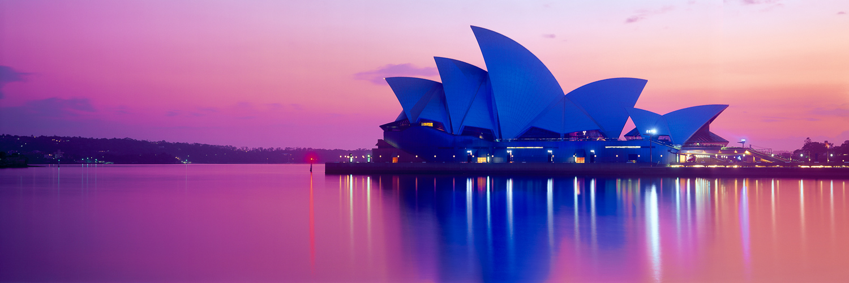 A hot pink sunrise over Sydney Opera House, NSW, Australia.