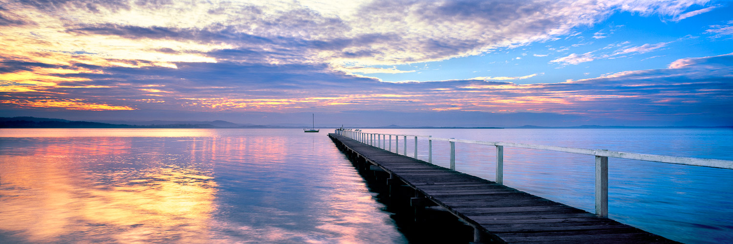 A golden sunset over Long Jetty, Central Coast, NSW, Australia.