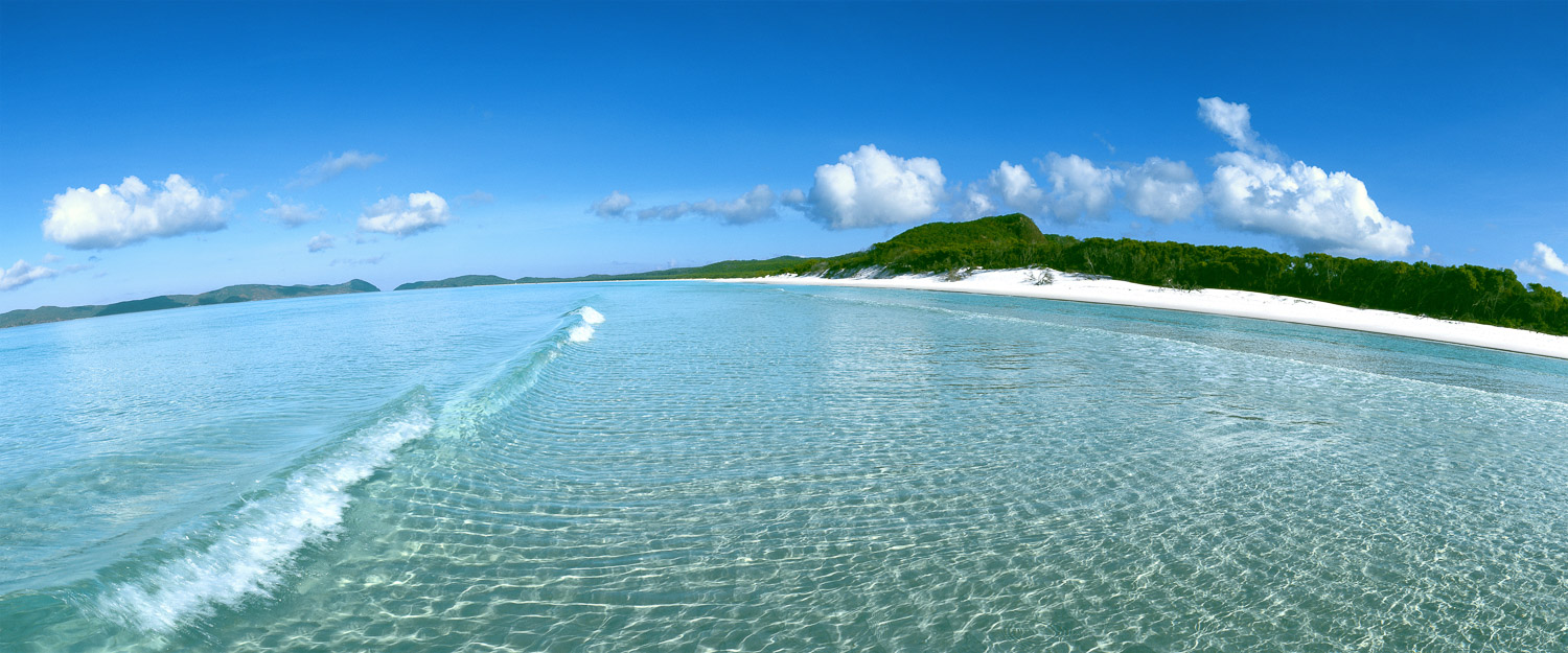 Crystal clear water lapping the pure white sand of Whitehaven Beach, Whitsundays, Qld, Australia.