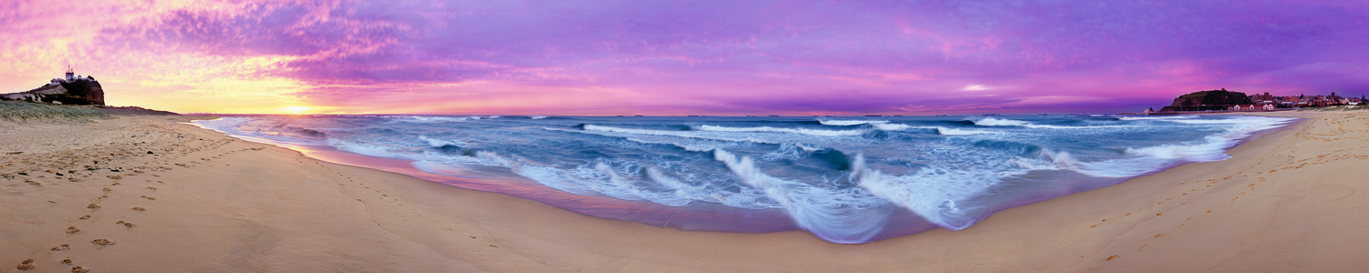 Delicate waves feathering the shores under a pastel sunrise, Nobby's Beach, NSW, Australia.