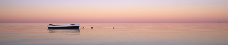A small dinghy at sunrise in Shark Bay, WA, Australia.