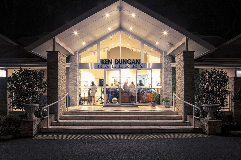 The Ken Duncan Gallery lit up at night for a private event