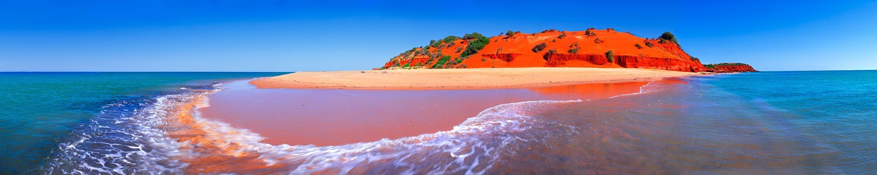The red sand and blue water of Cape Peron in mid-morning, WA, Australia.