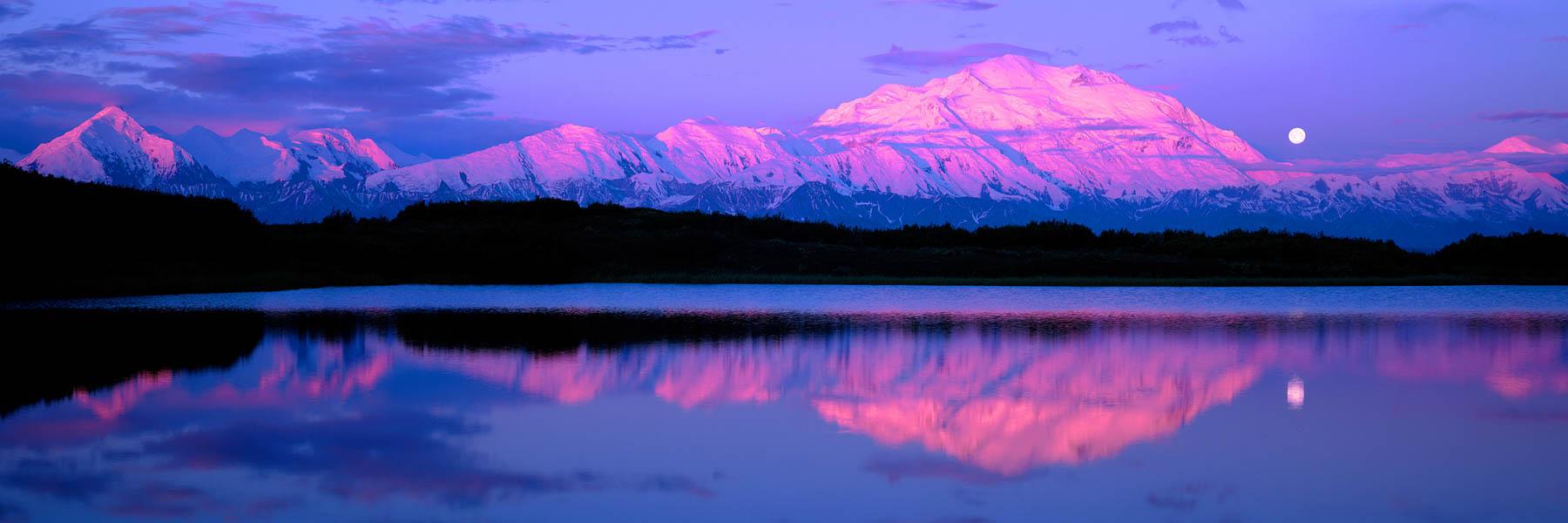 The snow capped peaks of Mount Denali, reflected in Wonder Lake, Alaska, USA.