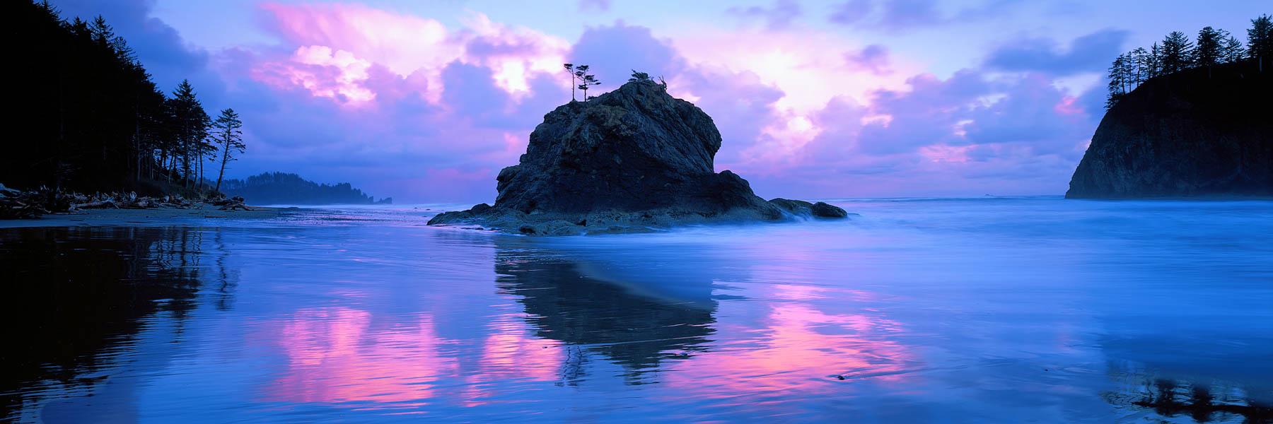 A glowing sunrise over sea stacks, Washington state, USA.