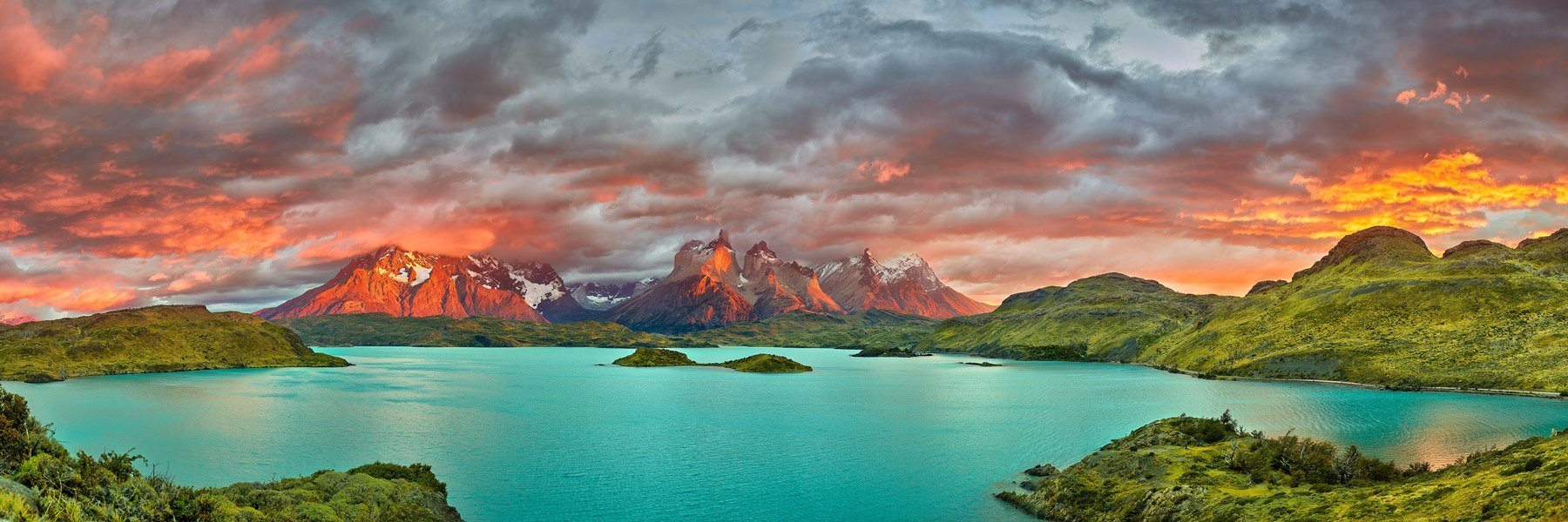 A brilliant sunrise exploding over a glacial lake, Torres Del Paine National Park, Patagonia, Chile.