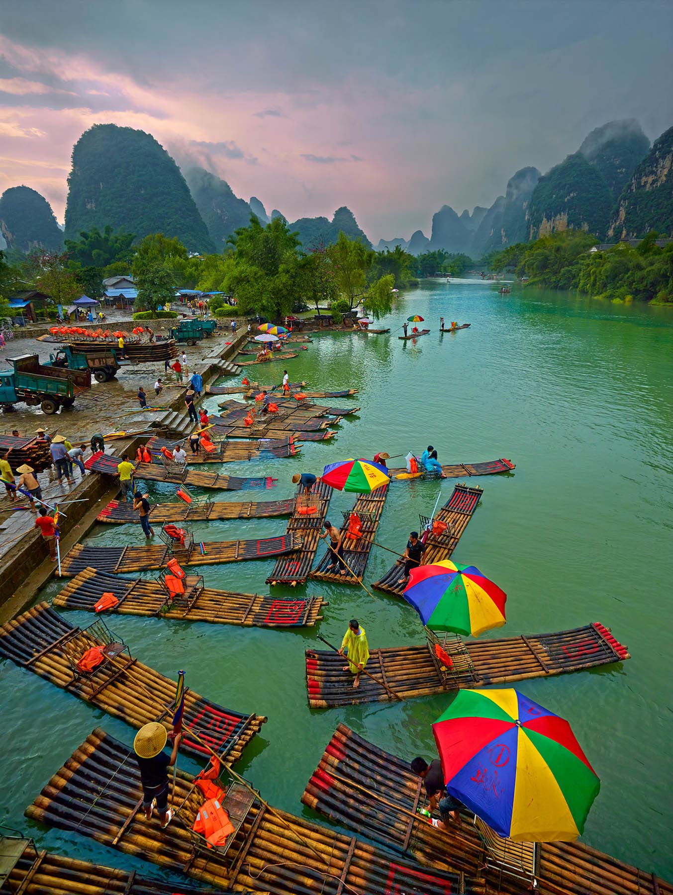 People loading boats on Jade Dragon River, Guilin, China.