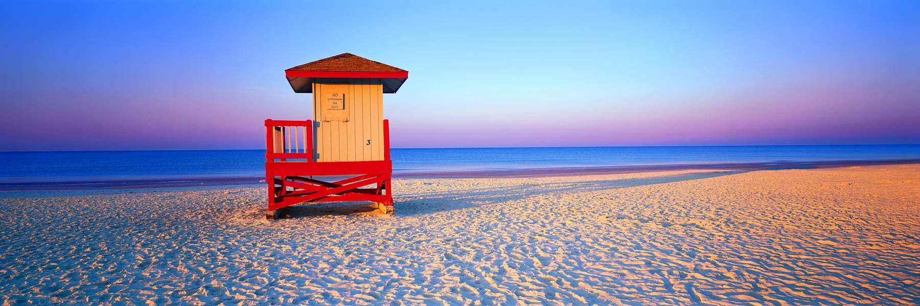 A pastel sunrise over Siesta Beach, Florida, USA.