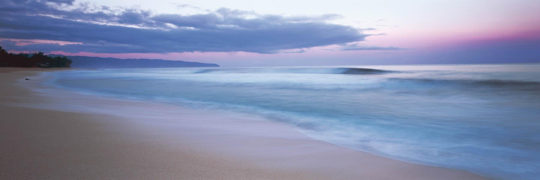 A pastel sunset over Oahu Beach, Hawaii, USA.