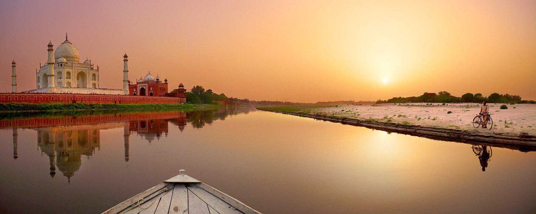 A golden sunrise over the Taj Mahal, Agra, India.