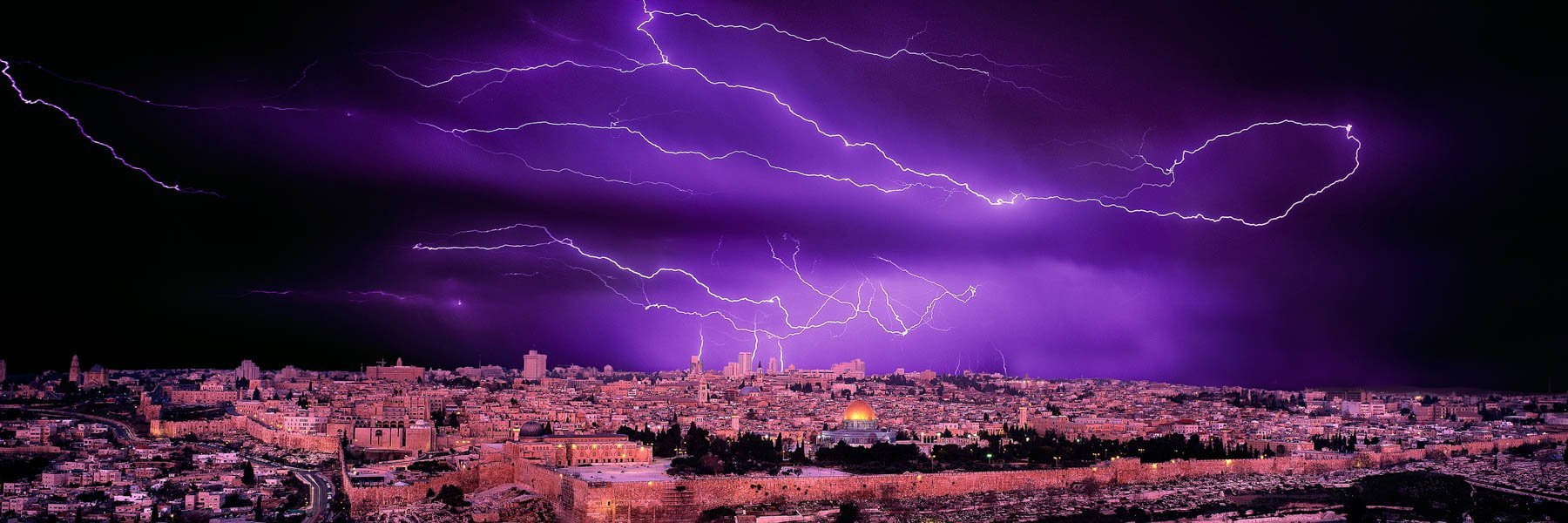 Lighnting flashes over the Holy City of Jerusalem, Israel.