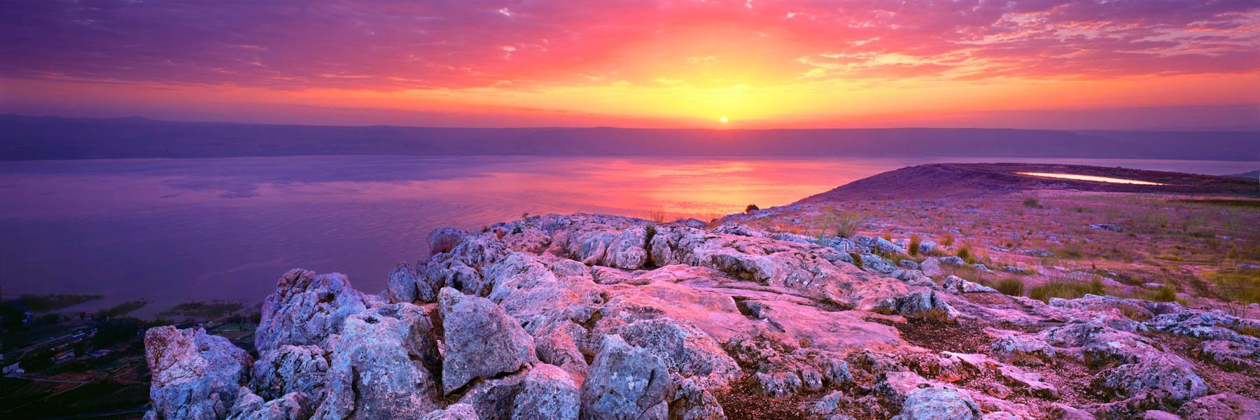 A red and golden sunrise over Mt Arbel, Israel.