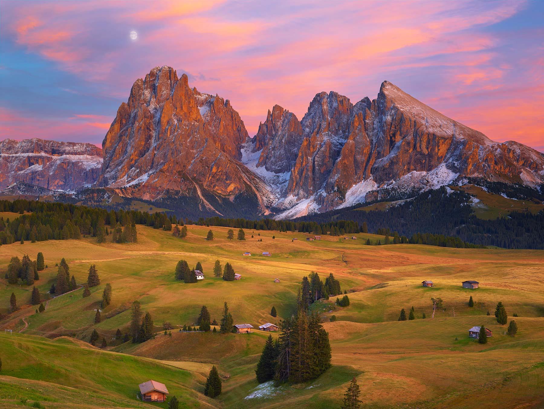 A radiant sun set over Alpe di Siusi, The Dolomites, Italy.