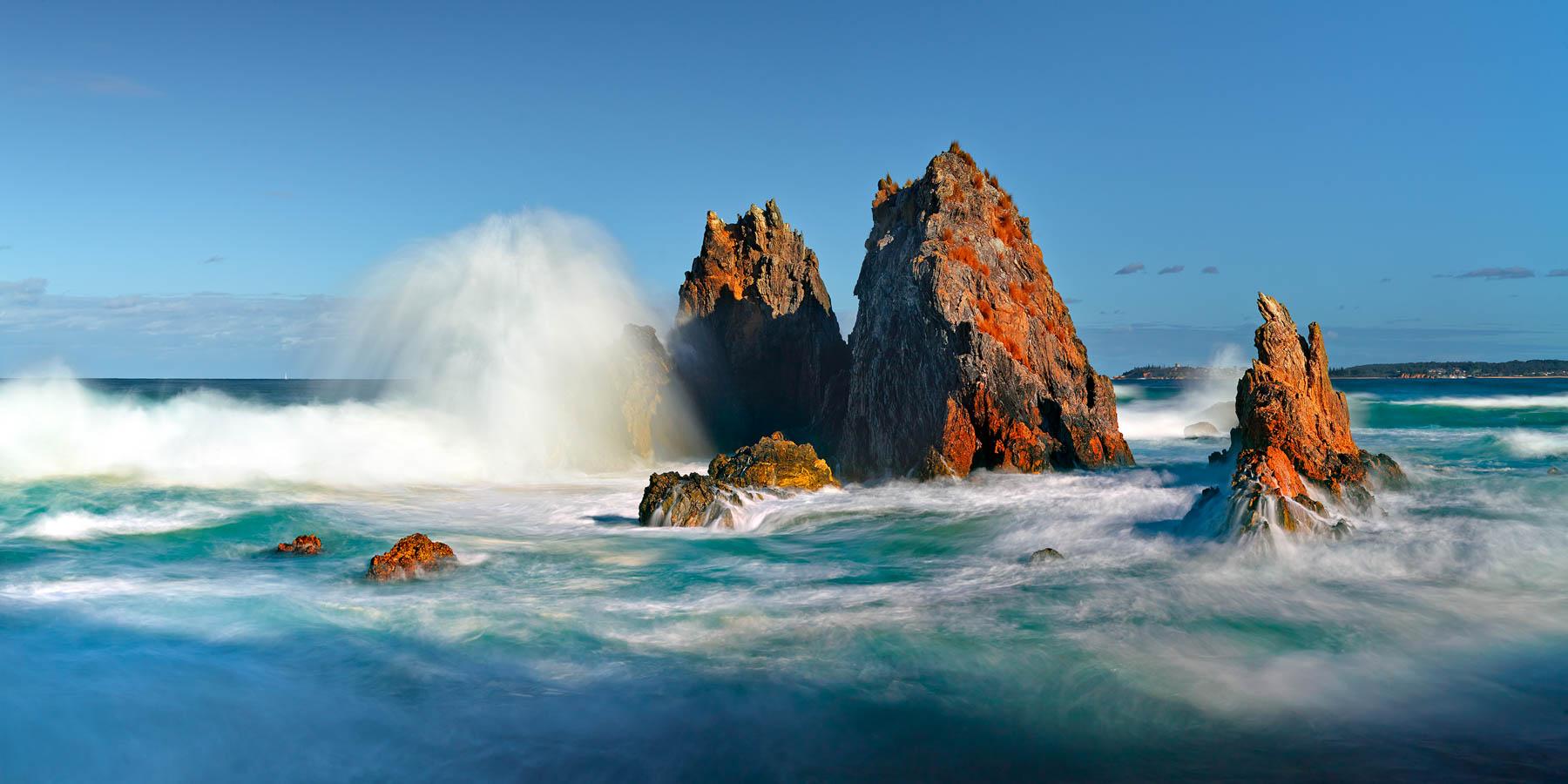 Waves crashing against Camel Rocks near Bermagui, Sapphire Coast, NSW, Australia.