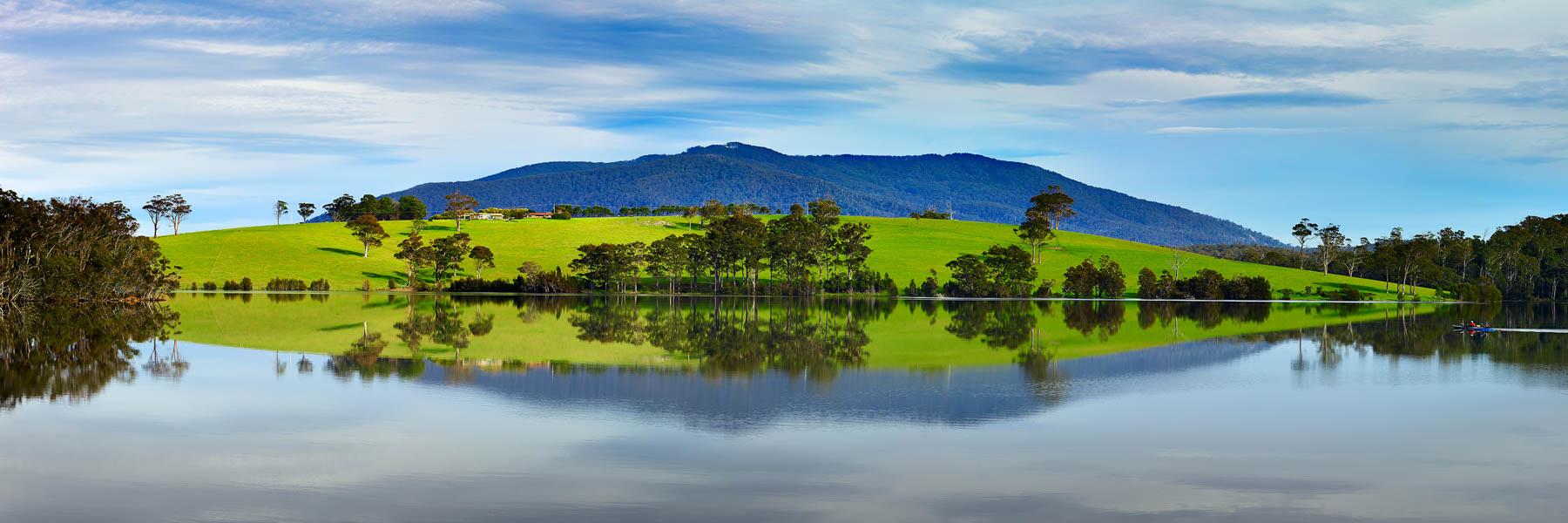 Perfect reflections in Corunna Lake, near Narooma, NSW, Australia.