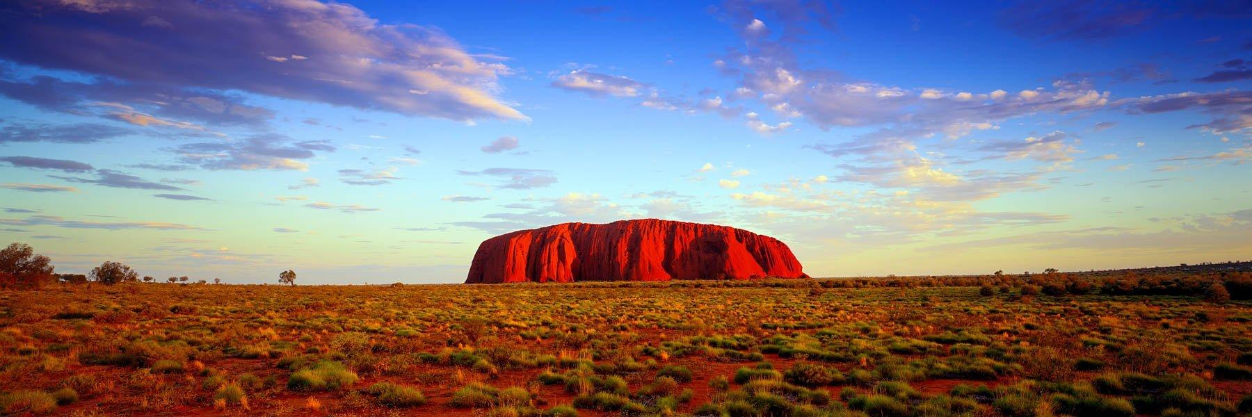 Uluru glowing red in the desert sunshine, NT, Australia.