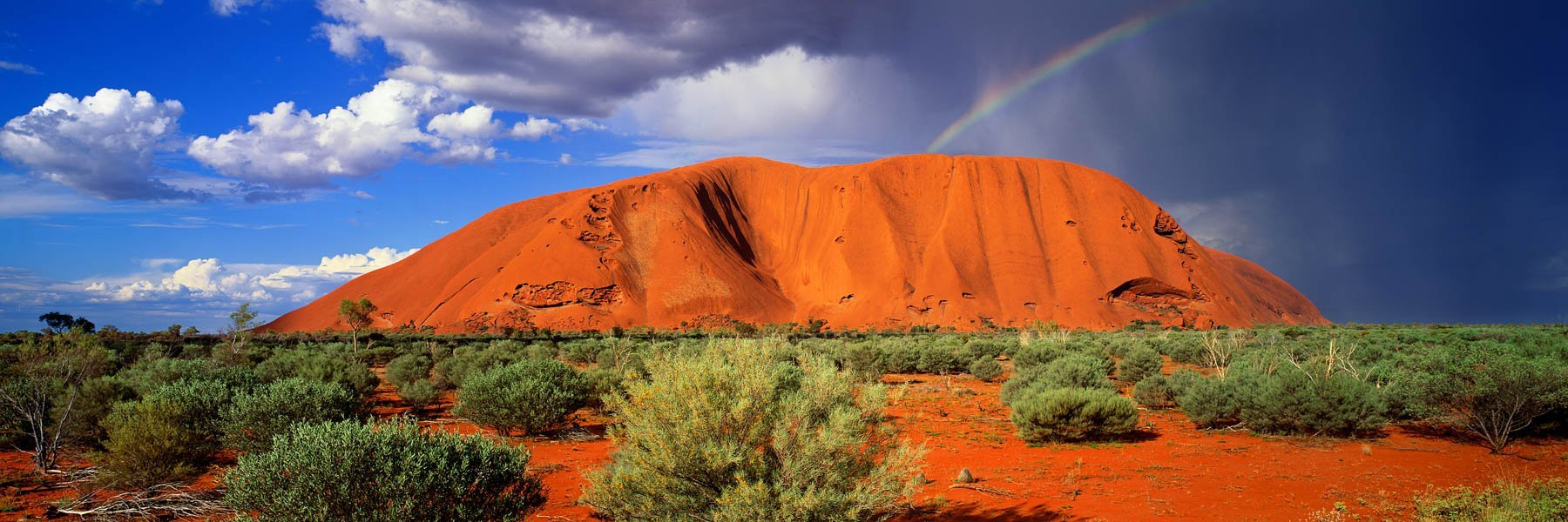 Rain showers over Uluru, NT, Australia.