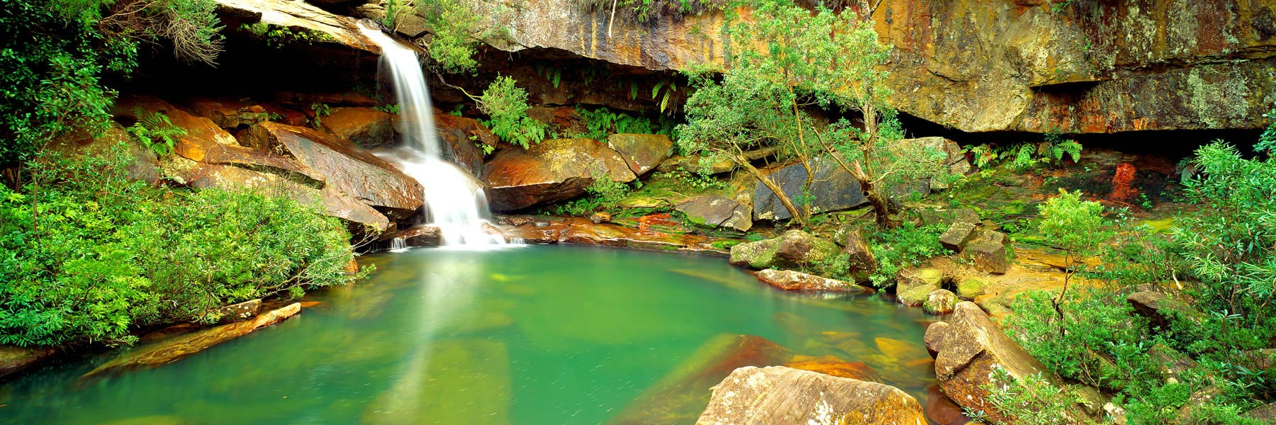 Upper Gledhill Falls flowing into a tranquil pool, NSW, Australia.