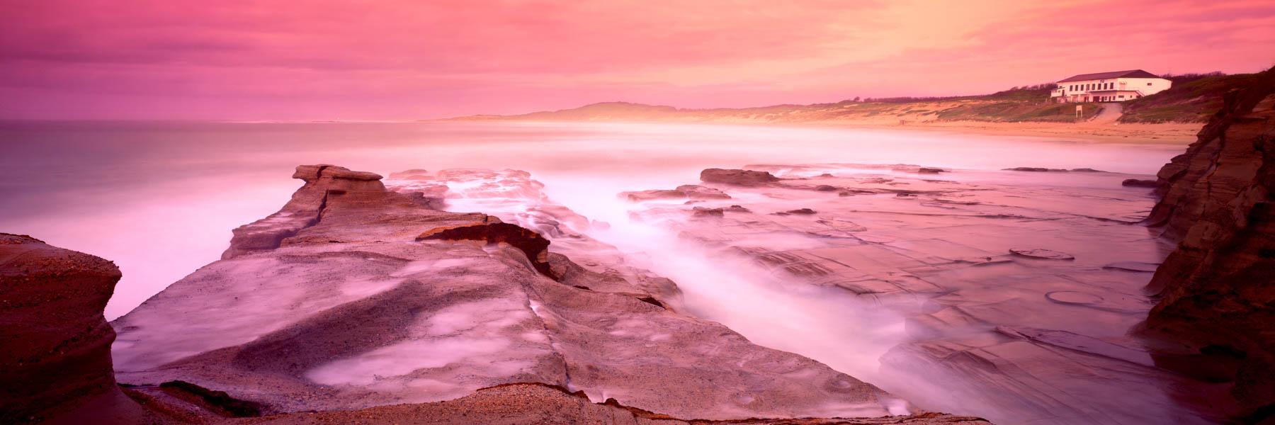 A stormy pastel sunrise at Soildiers Beach, Centgral Coast, NSW, Australia.