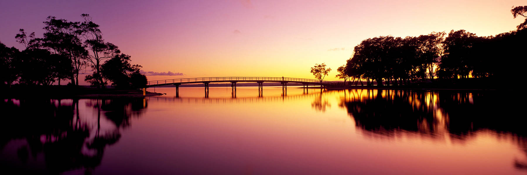 Perfect sunrise reflections at Budgewoi, Tuggerah Lakes, Central Coast, NSW, Australia.