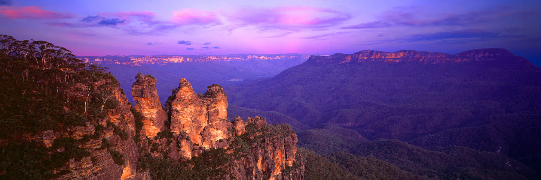 The glow of sunset lighting up The Three Sisters, The Blue Mountains, NSW, Australia.