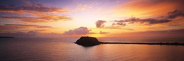 Golden sunrise over Barrenjoey Headland, Palm Beach, NSW, Australia.