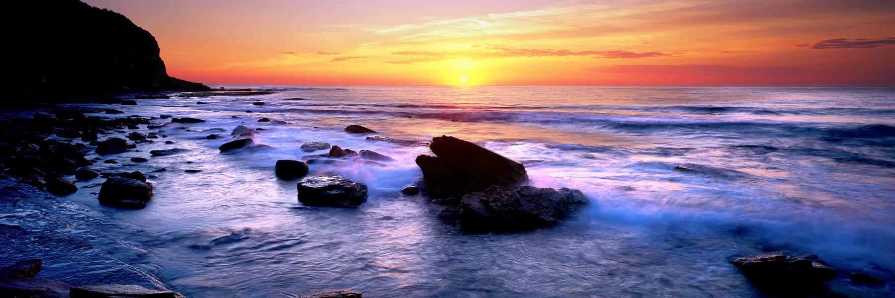 A golden sunrise over Turimetta Beach, NSW, Australia.