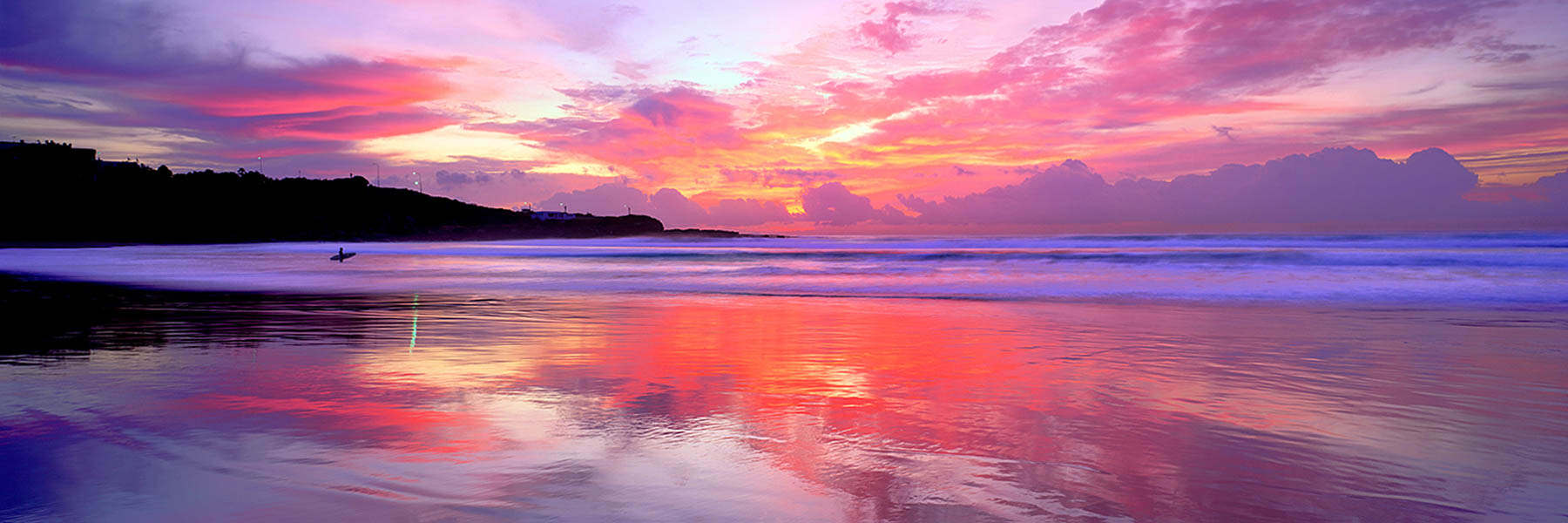 Brilliant sunrise display over Freshwater Beach, Sydney, NSW, Australia.