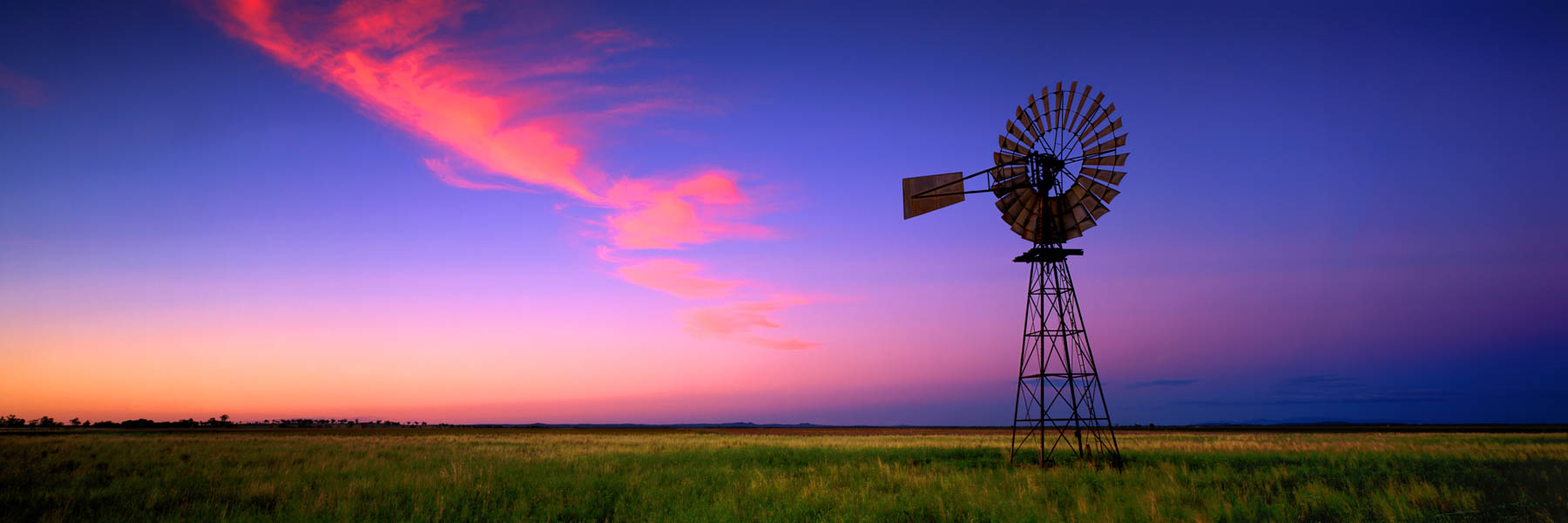 Windmill at sunset, Mullaley, western NSW, Australia.