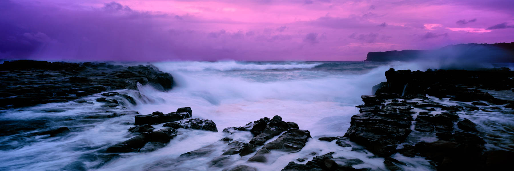 A wild and stormy sunrise at Avoca Beach, Central Coast, NSW, Australia.