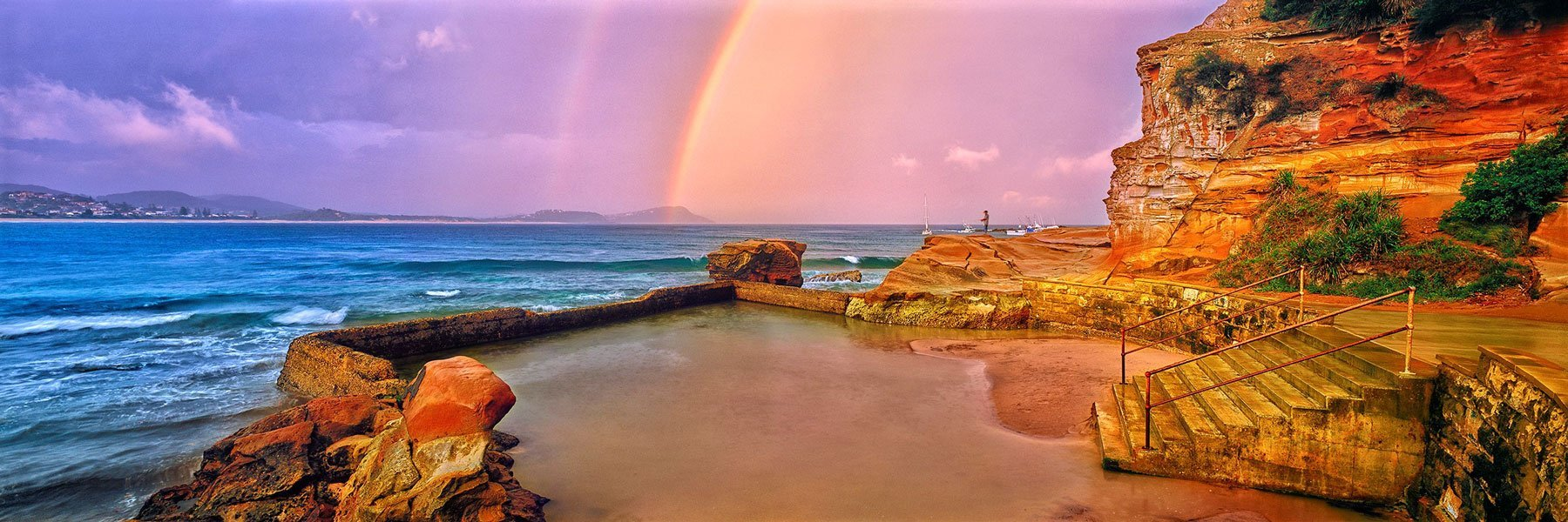 Rainbow after the storm at Terrigal Rock Pool, NSW, Australia