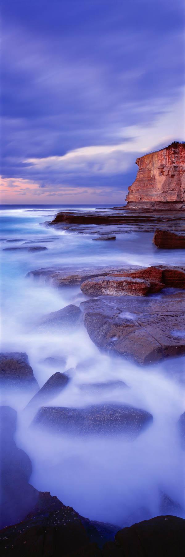 A moody, blue sunrise, over The Skillion, Terrigal, NSW, Australia.