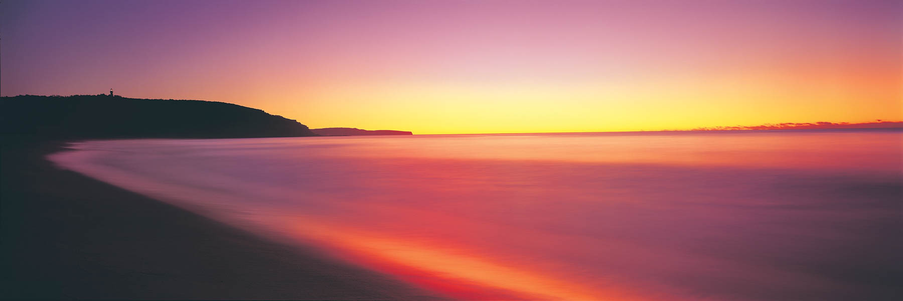 Red sunrise over Barrenjoey lighthouse, Palm Beach, Sydney, NSW, Australia.