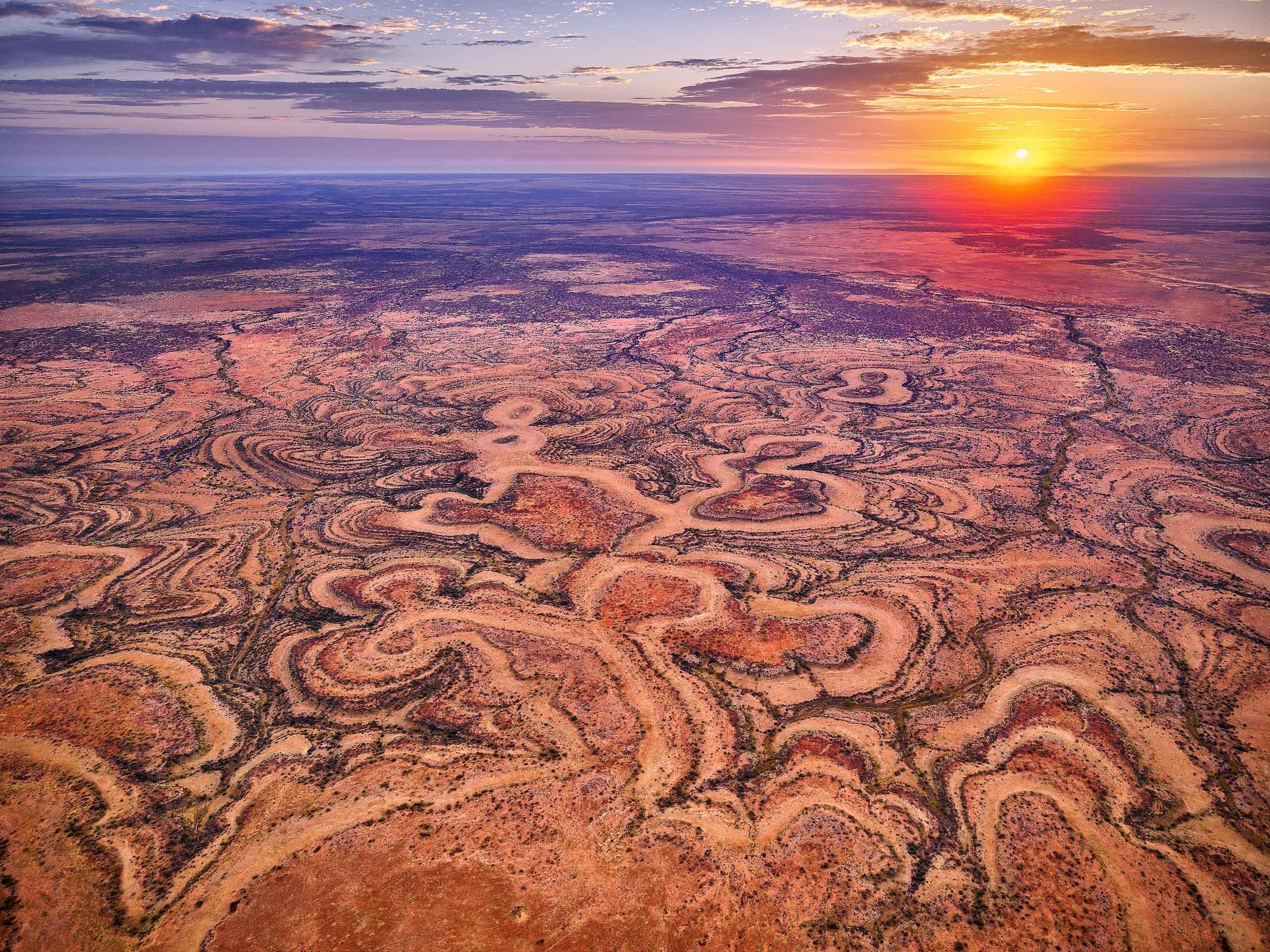 A golden sunrise over Running Man Rock, western Qld, Australia.