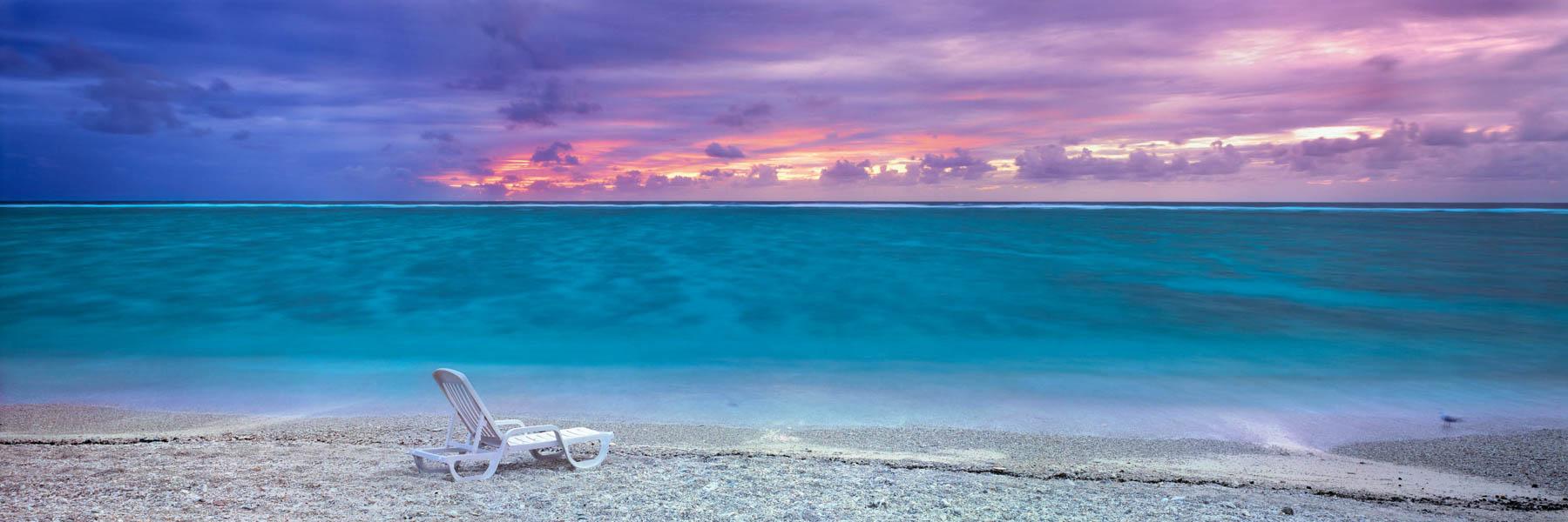 Sunrise breaking through heavy cloud, lLady Elliott Island, Great Barrier Reef, Qld, Australia.