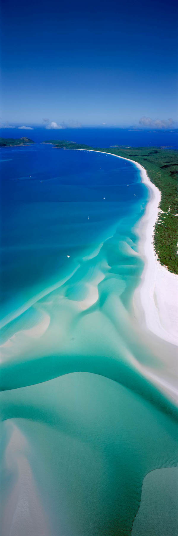 An aerial view of pure while sand swirling through turquoise water, Hill Inlet, Whitsundays, Qld, Australia.