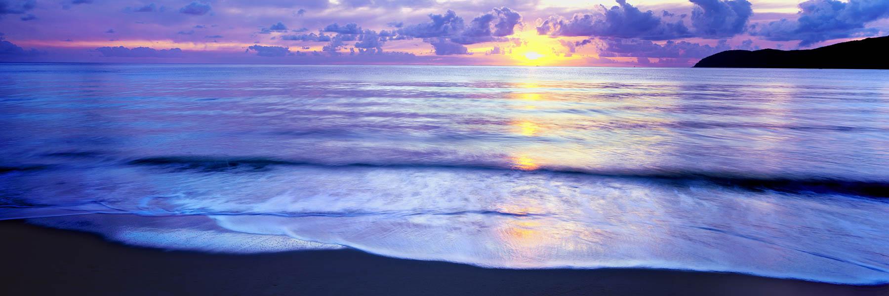 A glowing sunrise over Palm Island, north Qld, Australia.