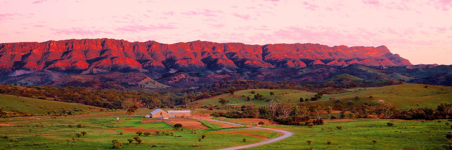 a glowing sunrise over Arkaba Woolshed and the Flinders Ranges in South Australia.