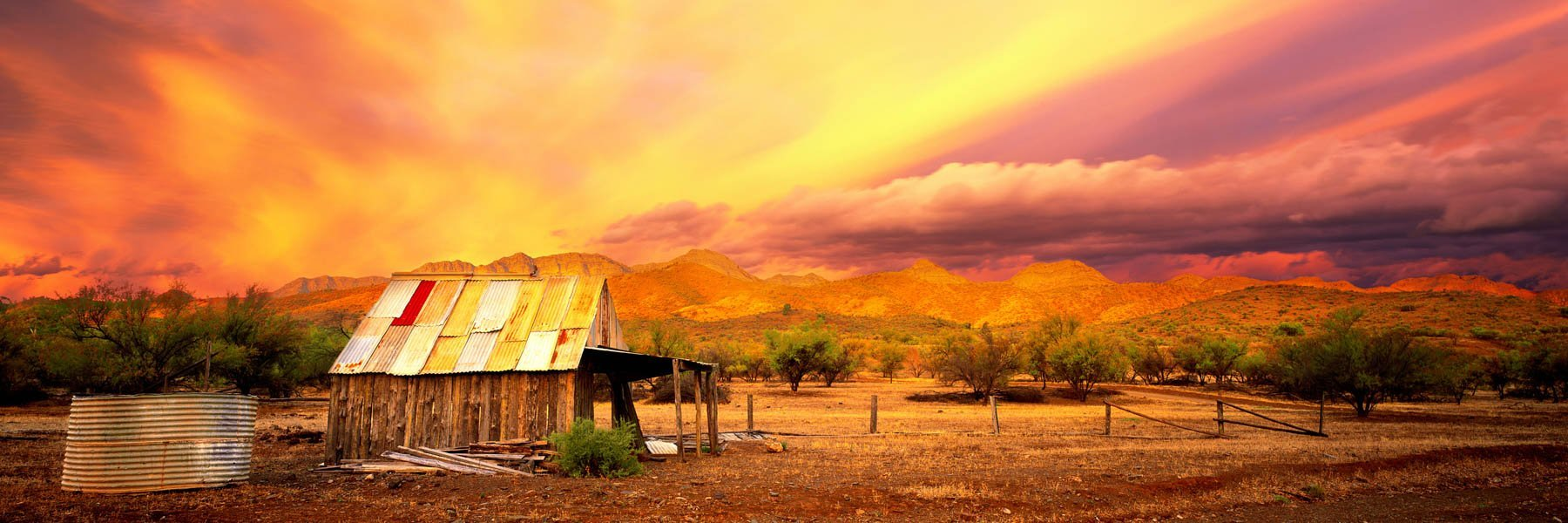 Ablaze with the fires of sunset, a magnificent sky draws its embers across the desolate Flinders Ranges, SA, Australia.