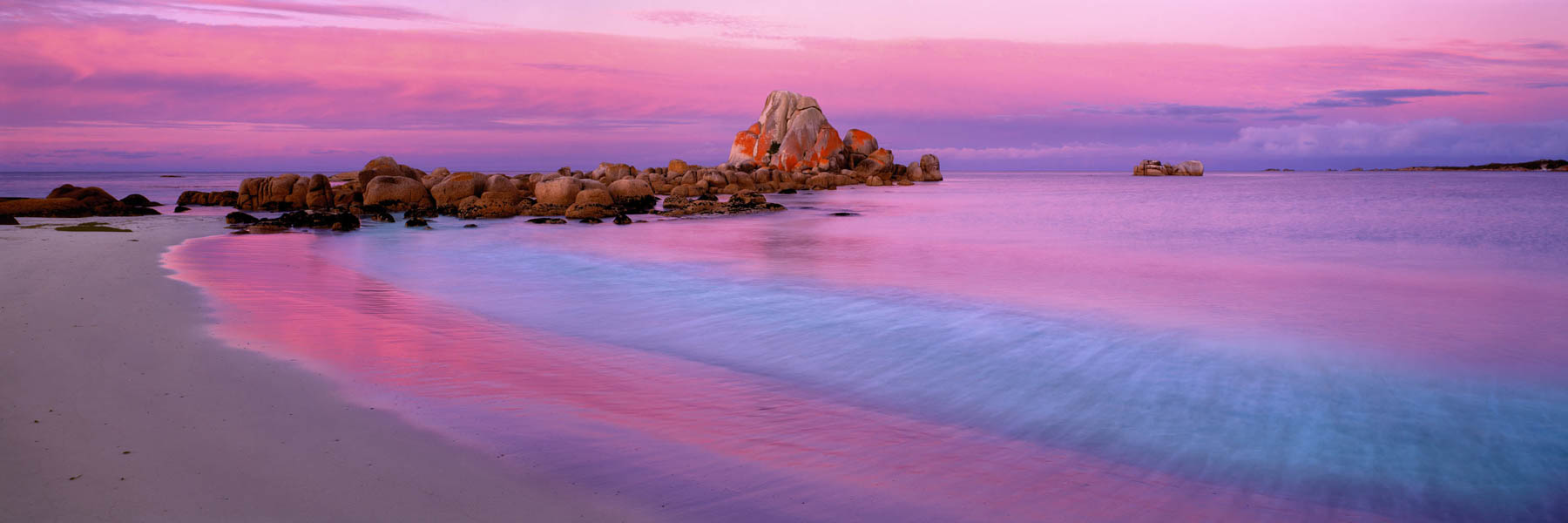Pink twilight glow over Picnic Rocks in Tasmania