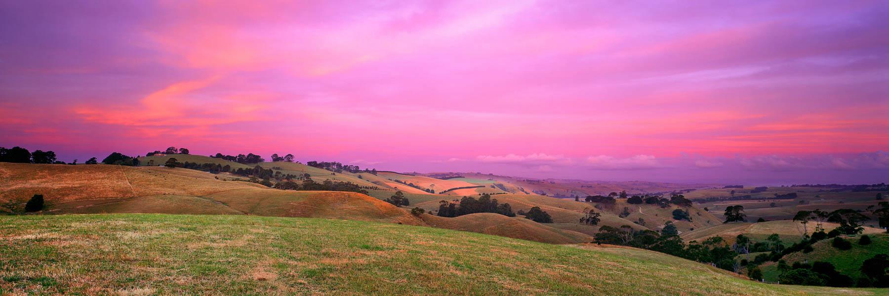 A pastel twilight glow over fields, Korumburra, Victoria, Australia.