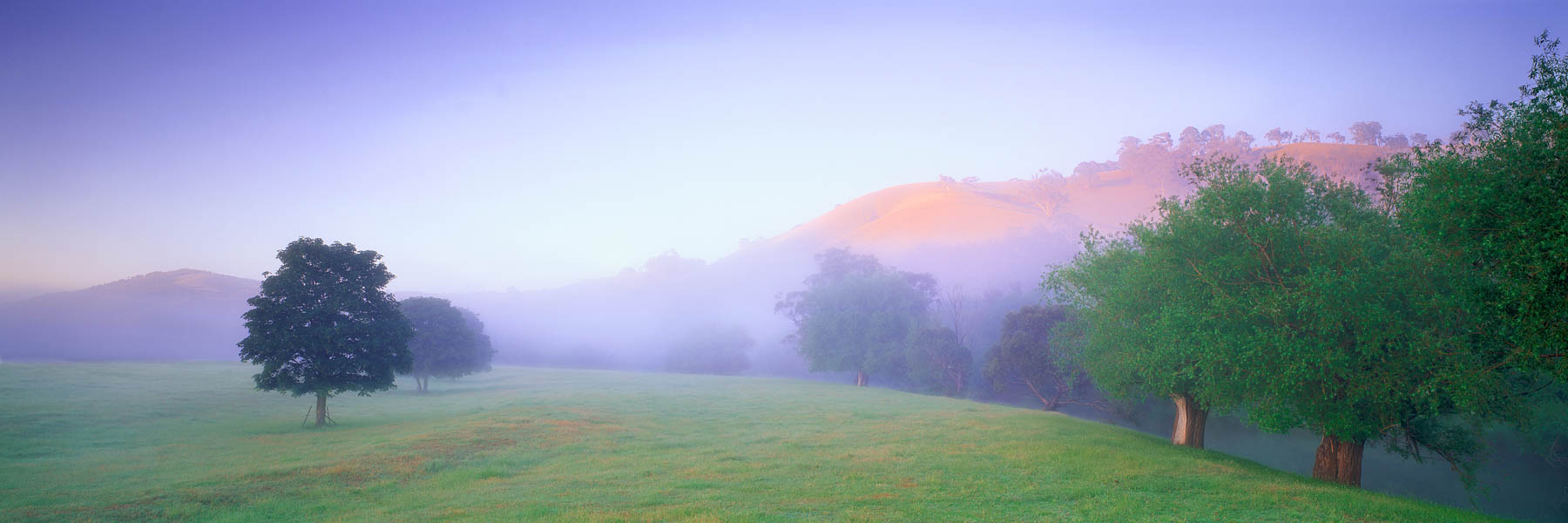 Mist hanging over the Omeo Valley at sunrise, Victoria, Australia.