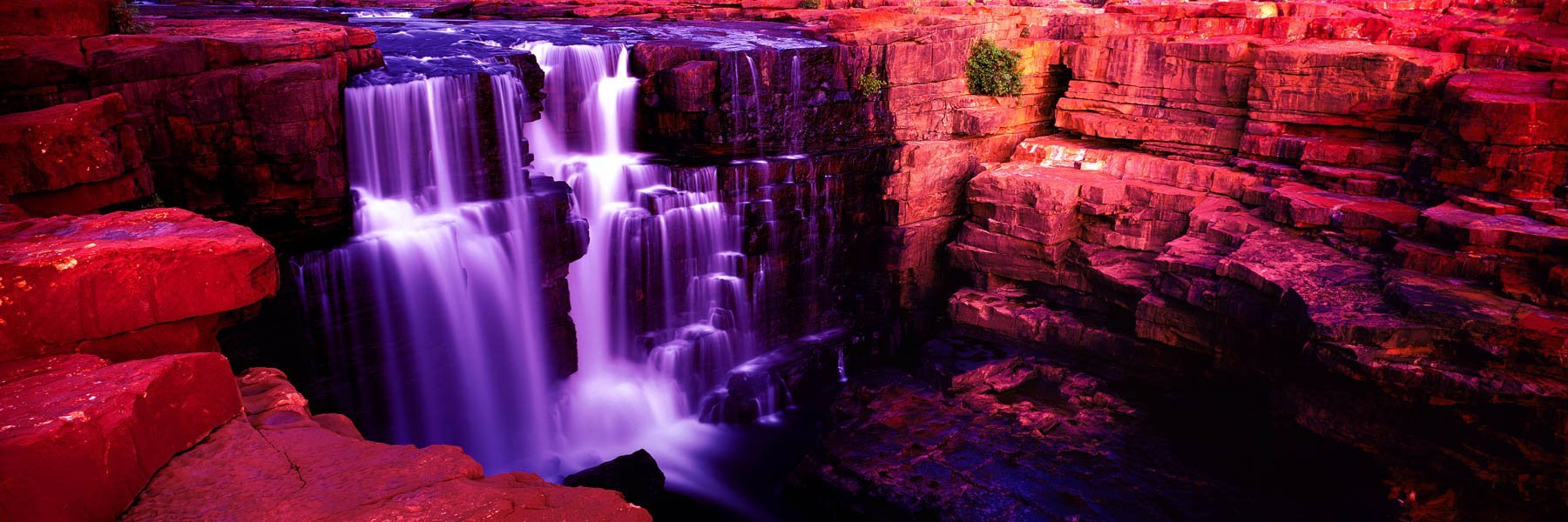 Water falling like soft satin down the tiers of Mitchell Falls, Kimberley, WA, Australia.